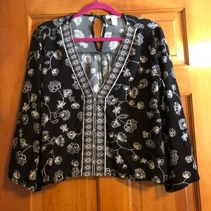 Black and white floral bell sleeve shirt